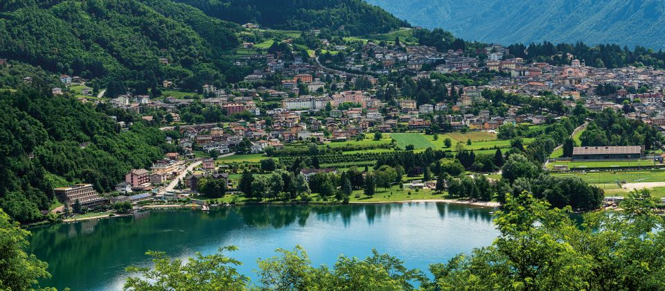Aerial view of the small town of Levico Terme with the lake (Lag