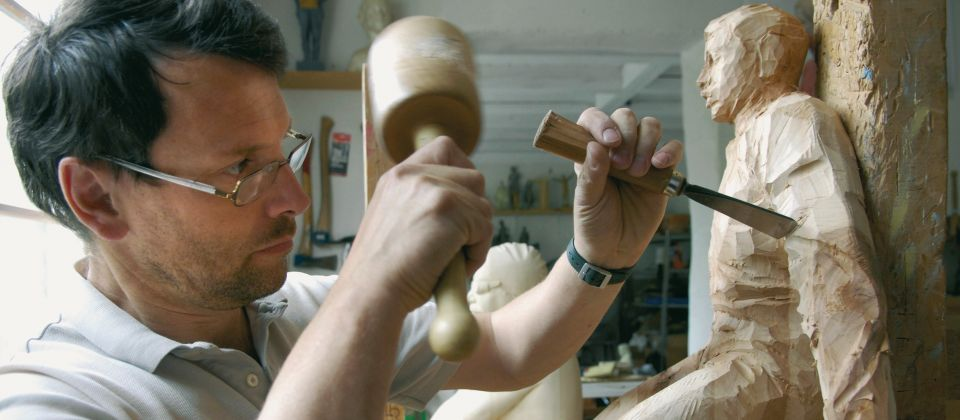 Holzschnitzer Beitragsbild